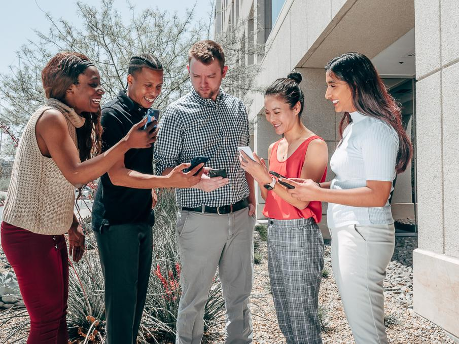 group looking at phones